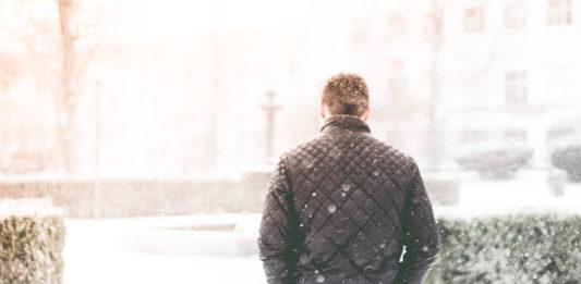 Man Walking in Snowfall Photo by Viktor Hanacek